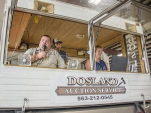 Auctioneer performing services from his camper