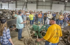 people in warehouse at weekend estate sale