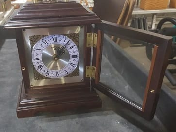 Counter clock with glass door open