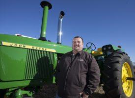 Auctioneer by John Deere green tractor
