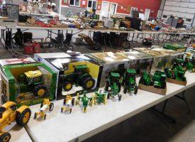 various sized john deere metal toy tractors